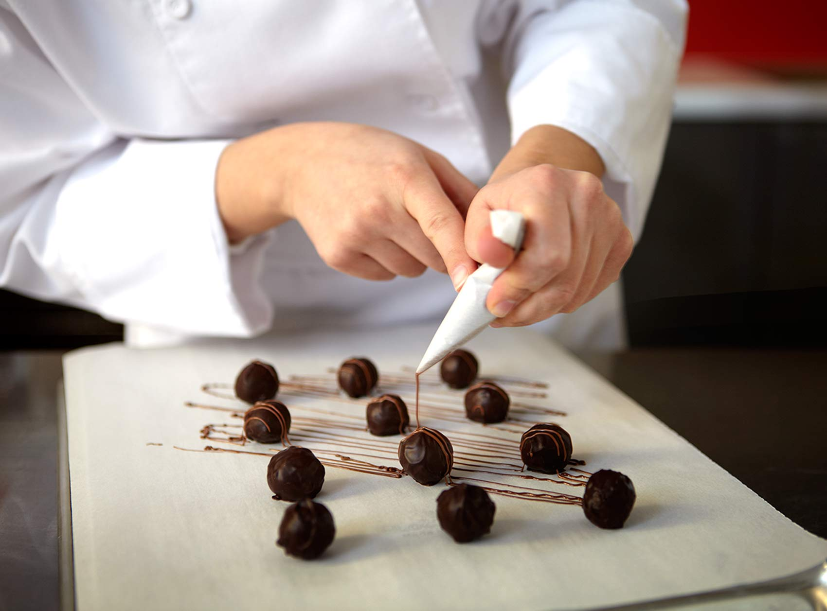 piping chocolate on truffles